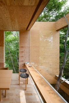 Large panels of glass almost disappear when you look out to the green forest.
