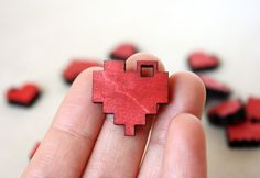 "Red Pixel Heart Necklace, Geek Gamer Jewelry in Birch Wood, ""I Love You in Pixels"". $9.50, via Etsy."