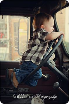 :) too adorable I think he is going to be a good driver when he grows up!