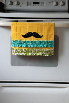 Yellow mustache hand towels.