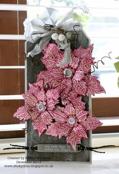 That's Life: Tim Holtz Tattered Poinsettia die http://stickydots.blogspot.co.uk/2013/12/there-are-always-flowers.html