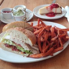turkey club with sauces on the side bacon, sweet potato fries