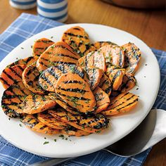 Grilled Sweet Potatoes #recipe: Rather than serving sweet potatoes in halves or wedges, try these savory slices. A sprinkling of cilantro or parsley makes the dish special.