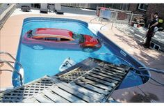 Just... Wow.    Driving lesson gone wrong ends with Dodge Caliber landing in Ontario swimming pool
