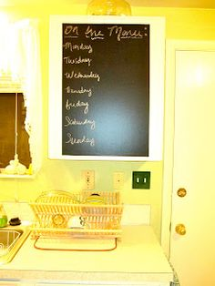chalkboard contact paper on a kitchen cabinet!