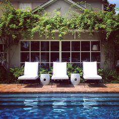 Boxwood Interiors, Houston | Janus et Cie chaise | brick pool perfection