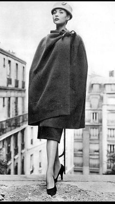 1956 Renée Breton in an enveloping wool cape tied in bow-knot on the shoulder by Balenciaga, photo by Georges Saad, Paris cape
