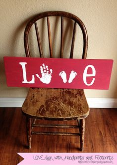 cute child artwork for home decor - spell love with hand print and feet prints.