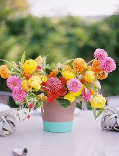 paint-dipped planter, photo by Ben Q Photography, flowers by Bows and Arrows http://ruffledblog.com/color-pop-wedding-ideas #yellow #pink #centerpieces