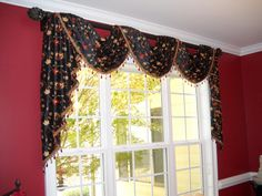 #WindowTreatments in a Dining Room  Pole #Swags in black embroidered faux silk with a beautiful bead fringe!