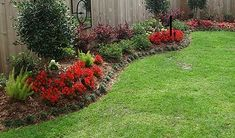 Landscaping Ideas for the Backyard - don't want to overdo the maintenance but need more than just really green grass? Check out this idea.  Simple mulch beds with flowers of your choosing.  It's a little more than minimal and won't break the back or the budget.