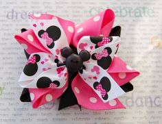 Minnie Mouse inspired hair bow...Pink, Black and White Boutique Hair Bow with Mickey button embellishment. $12.00, via Etsy.