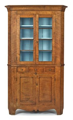 Sold $12,000 Vibrant Pennsylvania tiger maple corner cupboard, ca. 1820, with a cove molded cornice over two four-lite doors, 83'' h., 44'' w.