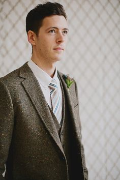 tweed jacket and vest, photo by Our Labor of Love by Heidi http://ruffledblog.com/gilded-winter-romance #groom #wedding
