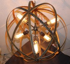 Metal Sphere Chandelier Elegant, industrial chandelier.  Perfect industrial style lamp for wine bars, gazebos, outdoor or backyard settings. These unique light fixtures accent homes, patios or winery décor. Perfect for any style of interior decoration from industrial / rustic to the more modern and contemporary.