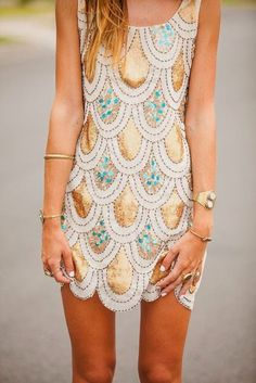 beautiful scalloped dress embellished w/ aqua and gold accents.