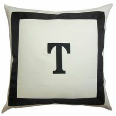 "Cotton pillow with a black initial detail and matching grosgrain border. Made in the USA.  Product: PillowConstruction Material: Cotton and 95/5 down fillColor: BlackFeatures:  Insert includedHidden zipper closureMade in the USA Dimensions: 18"" x 18""Cleaning and Care: Spot clean"