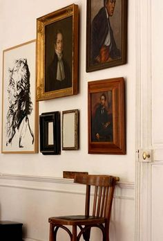 Gallery wall with old paintings