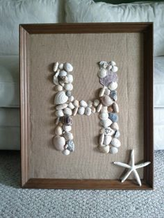$1 frame from Peddlers Mall, old shells from a beach themed room, & leftover burlap. Ocean bedroom décor.