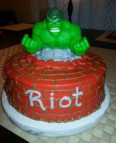Incredible Hulk cake.  The Hulk figurine is a bank.