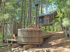| Eau Claire River Tiny House | A 128 square feet lake tiny house on stilts with wood-fired hot tub in Gordon, Wisconsin. ~ click on photo for more ~