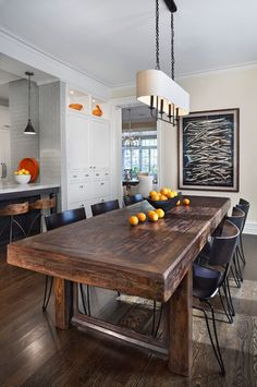 Love this rustic table mixed with more contemporary elements by Tom Stringer Design Partners; Also can't help but love the Donghia Klismos chairs.