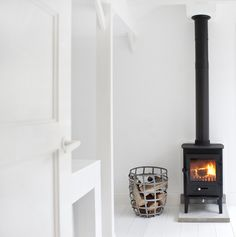 black modern wood stove in white room
