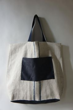 Oversized tote made of vintage linen grain sack and leather, by Stitch and Tickle on Etsy