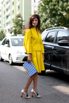 Not-so-mellow yellow with a few high-impact add-ons to boot. fashion weeks, blue, milan fashion, clutch, street styles, street style fashion, spring 2014, shoe, week spring