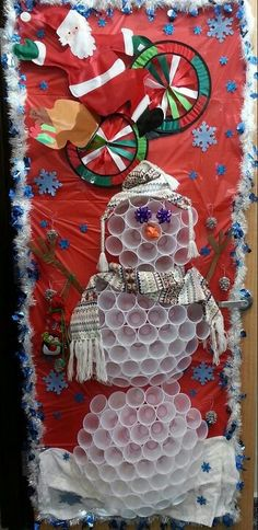 Snowman made of used and recycled items for a door decoration contest!