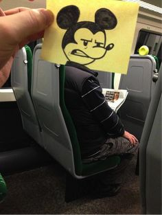 this artist spends his train commute drawing funny drawings that replace his fellow commuters' heads {so funny!}