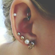 I love this. Three lobe piercings, a cartilage and my favorite, the rook piercing!