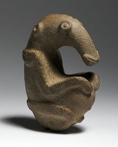 The Ambum stone, Papua New Guinea. Pre-historic zoomorphic figure; possibly representing the embryo of a long-beaked echidna] c.1500 BCE. Greywacke stone. Collection of the National Gallery of Australia.