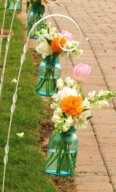 aqua mason jars on shepherd hooks lined the aisle