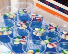beach party: striped gummy fish floating in blue Jello