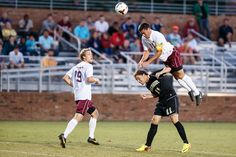 Up, up and away! #Elon midfielder Daniel Lovitz goes over a Wake Forest player to win a header.
