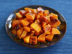 Maple Cinnamon Roasted Butternut Squash - Easy and delicious! I prefer to toss the squash with the  seasonings in a bowl rather than on the sheet pan.