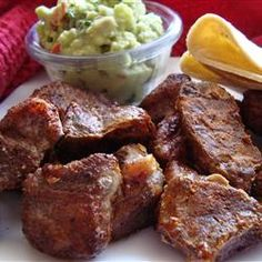 "Chile Pork | ""I love this and make it often. Instead of cooking it in the oven I cook it in a skillet on the stove hot and fast. Pork is very tasty and juicy this way, saves time too. I serve them on corn tortillas with lime, guacamole, and cheese."""