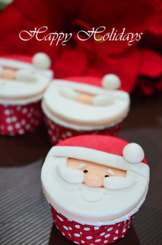 Santa Cupcake with fondant toppers. So festive and adorable!
