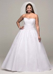 A classic look for any stylish bride wanting to feel beautiful on her special day!   Strapless bodice features stunning sequin detail.  Corset back shapes a flattering figure and ensures the perfect fit.  Tulle ball gown adds extra flare to this already sensational number.  Chapel train. Sizes 16W-26W.  Available in stores in and online in White. Ivory available by special order in store only. Fully lined. Corset back. Imported polyester. Dry clean only.
