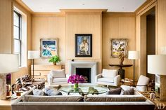Steven Harris and Lucien Rees Roberts Craft Their Dream New York Apartment A pair of paintings by Rees Roberts flank one by his mother, Ursula McCannell.