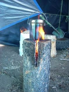 Gain unbeatable camping cred by cooking on a Laplander stove.    What to do: Find a sturdy, medium-sized log. Cut slits into the top to form a cross-shape. Stuff slits with bark, sticks and leaves. Set alight and cook your food.