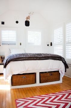 Good idea for a bed in a small room (cause you can't fit a bench in front of a bed in a small room!)