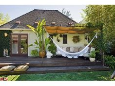 deck retreat - fabric panels for shade covering the knitted hammock and sectional with neutral throws