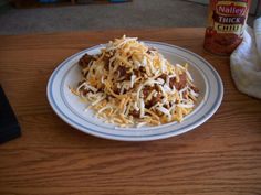 cream cheese dip:Pour a can of chili over the cream cheese and top with shredded cheddar. Microwave until just warm.