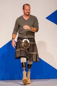 Staff Sgt. Dan Nevins of Wounded Warriors Project. - nobody ever looked better in a kilt!