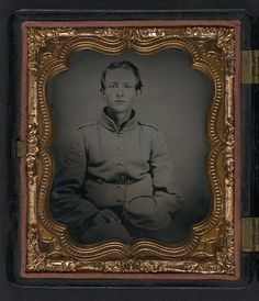 Unidentified young soldier Confederate uniform with kepi