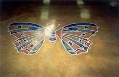 This pretty concrete graphic was created with a concrete stencil and concrete stains.  Brooks Construction Services Inc Sioux Falls, SD