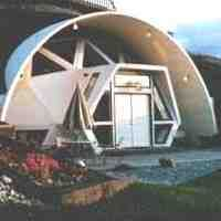 earth sheltered dome with passive annual heat storage