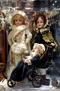 vintage dolls in store window